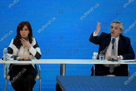 Argentina's President Alberto Fernandez speaks as his Vice President Cristina Fernandez sits next to him during a ceremony announcing the results of a debt swap, at the Casa Rosada government house in Buenos Aires, . The Argentine government formalized an agreement with private creditors to restructure its debt for 65 billion dollars after five months of tense negotiations
