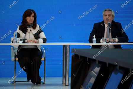 Stock Photo of Argentina's President Alberto Fernandez (R) delivers a speech next to Argentina's vice-president Cristina Fernandez de Kirchner during a ceremony announcing the results of the debt swap at the Casa Rosada government house in Buenos Aires, Argentina, 31 August 2020. The Argentine government formalized the agreement with private creditors to restructure its debt for 65 billon dollards after five month of tense negotiations.
