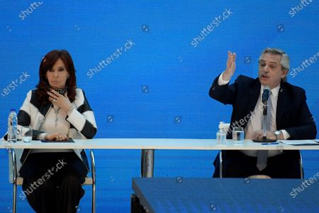 Argentina's President Alberto Fernandez (R) delivers a speech next to Argentina's vice-president Cristina Fernandez de Kirchner during a ceremony announcing the results of the debt swap at the Casa Rosada government house in Buenos Aires, Argentina, 31 August 2020. The Argentine government formalized the agreement with private creditors to restructure its debt for 65 billon dollards after five month of tense negotiations.