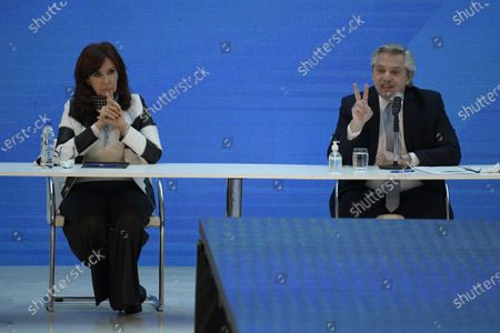 Stock Image of Argentina's President Alberto Fernandez (R) delivers a speech next to vice-president Cristina Fernandez de Kirchner (L), during a ceremony announcing the results of the debt swap at the Casa Rosada government house in Buenos Aires, Argentina, 31 August 2020. The Argentine government formalized the agreement with private creditors to restructure its debt for 65 billon dollards after five month of tense negotiations.