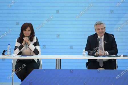 Argentina's President Alberto Fernandez (R) and vice-president Cristina Fernandez de Kirchner (L), gesture before the start of the ceremony announcing the results of the debt swap at the Casa Rosada government house in Buenos Aires, Argentina, 31 August 2020. The Argentine government formalized the agreement with private creditors to restructure its debt for 65 billon dollards after five month of tense negotiations.