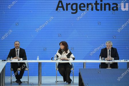 Argentina's Economy minister Martin Guzman (L) delivers a speech next to Argentine President Alberto Fernandez (R) and vice-president Cristina Fernandez de Kirchner (C), during a ceremony announcing the results of the debt swap at the Casa Rosada government house in Buenos Aires, Argentina, 31 August 2020. The Argentine government formalized the agreement with private creditors to restructure its debt for 65 billon dollards after five month of tense negotiations.