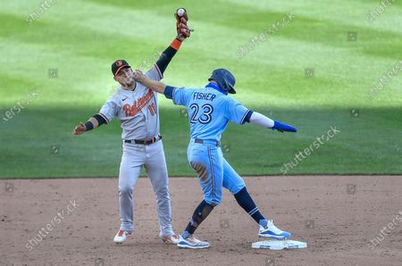 Toronto Blue Jays' Derek Fisher, right, is tagged out by Baltimore Orioles shortstop Jose Iglesias trying to steal second during the ninth inning of a baseball game in Buffalo, N.Y., . The call was upheld after a challenge by Toronto