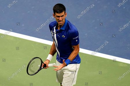 Novak Djokovic, of Serbia, reacts after a winning a set against Damir Dzumhur, of Bosnia and Herzegovina, during the first round of the US Open tennis championships, in New York
