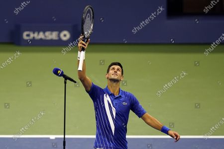 Novak Djokovic, of Serbia, reacts after defeating Damir Dzumhur, of Bosnia and Herzegovina, in the first round of the US Open tennis championships, in New York