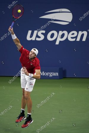 John Isner, of the United States, serves to Steve Johnson, of the United States, during the first round of the US Open tennis championships, in New York