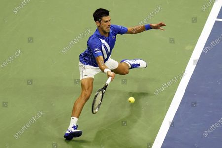 Novak Djokovic, of Serbia, returns to Damir Dzumhur, of Bosnia and Herzegovina, during the first round of the US Open tennis championships, in New York