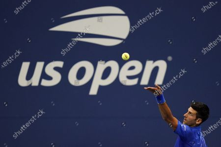 Novak Djokovic, of Serbia, serves to Damir Dzumhur, of Bosnia and Herzegovina, during the first round of the US Open tennis championships, in New York