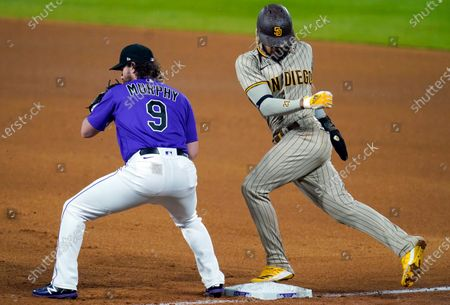 Stock Photo of San Diego Padres' Fernando Tatis Jr., right, jumps back to first base as Colorado Rockies first baseman Daniel Murphy pulls in a pickoff throw from relief pitcher Jeff Hoffman in the seventh inning of a baseball game, in Denver. The Padres won 6-0