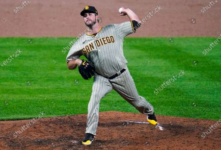 San Diego Padres starting pitcher Drew Pomeranz works against the Colorado Rockies in the eighth inning of a baseball game, in Denver. The Padres won 6-0