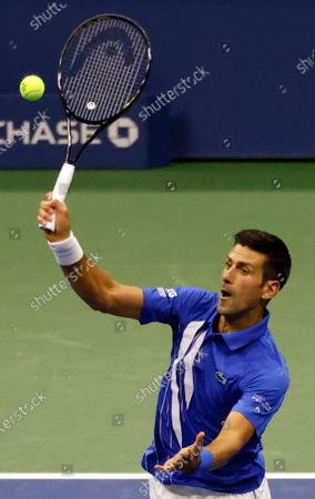 Novak Djokovic of Serbia hits a return to Damir Dzumhur of Bosnia and Herzegovina during their match on the first day of the US Open Tennis Championships the USTA National Tennis Center in Flushing Meadows, New York, USA, 31 August 2020. Due to the coronavirus pandemic, the US Open is being played without fans and runs from 31 August through 13 September.