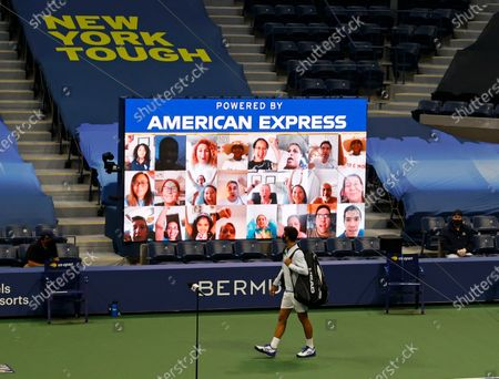 Stock Photo of Virtual tennis fans (top) greet Novak Djokovic of Serbia (bottom) as he walks onto the court to play Damir Dzumhur of Bosnia and Herzegovina on the first day of the US Open Tennis Championships at the USTA National Tennis Center in Flushing Meadows, New York, USA, 31 August 2020. Due to the coronavirus pandemic, the US Open is being played without fans and runs from 31 August through 13 September.