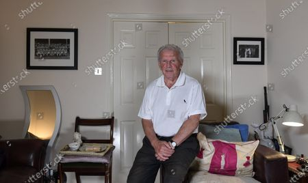 Stock Image of Surrounded by pictures of his family and former team-mates, Johnny Giles contemplates his own mortality. The Dubliner turns 80 this year and is the oldest surviving member of Leeds United's great title-winning sides of 1969 and 1974. How he wishes that Jack Charlton, five years his senior, was still here. Norman Hunter and Trevor Cherry, too. All three Leeds legends have died in recent months. A framed poster of their decorated team resides on the wall of Giles' sitting room here in Birmingham. Next to it, on the mantelpiece, a picture of Giles and his brother-inlaw, England World Cup winner Nobby Stiles. They are suited - no longer booted - but still smiling, two of the finest midfielders of their generation together at a family wedding. But that was then. Today, Stiles is cared for in a home, unaware of his surroundings, his mind defeated by Alzheimer's disease. 'What a great lad,' says Giles.