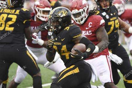 Missouri running back Larry Rountree III finds a hole in the Arkansas defense as he runs the ball during the first half of an NCAA college football game in Little Rock, Ark. Eli Drinkwitz already has experienced just about everything a college football coach could imagine in his first season. Except for playing a game. That will finally change on Sept. 26, 2020, when the Tigers' new coach leads his team into the opener of its SEC-only schedule against mighty Alabama