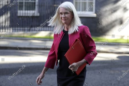 Amanda Milling Britain's Minister without Portfolio walks through Downing Street to attend a cabinet meeting in London, . Britain's Parliament resumes Tuesday following the summer break