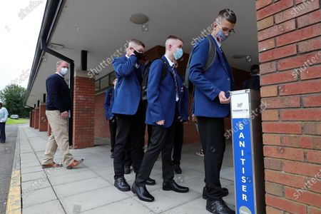 Pupils from Year 11 at Hazelwood Integrated College during their first day back to the north Belfast school. Post-primary pupils and teachers will be required to wear face coverings in school corridors and other communal areas.Education Minister Peter Weir said the measure would come into effect on 31 August when schools return full-time.