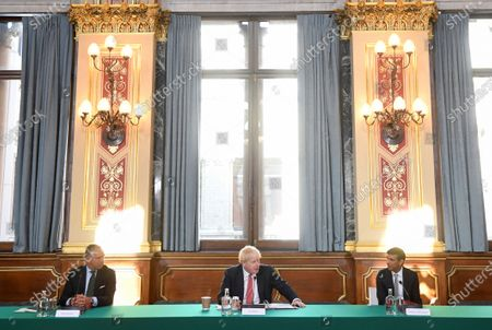 Britain's Cabinet Secretary Mark Sedwill, left, Britain's Prime Minister Boris Johnson and Britain's Chancellor of the Exchequer Rishi Sunak, right, attend a Cabinet meeting of senior government ministers at the Foreign and Commonwealth Office FCO in London