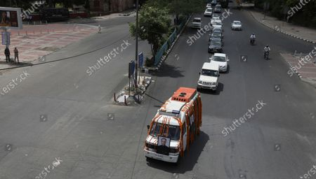 An ambulance carrying the body of former Indian President Pranab Mukherjee drives towards the cremation site in New Delhi, India, . Mukherjee, a senior leader of India's Congress party who served in multiple Cabinets during five decades in politics, died on Monday. He was 84