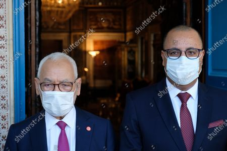 Prime minister designate Hichem Mechichi and President of Tunisian parliament Rached Ghannouchi pose for a portrait in front of his office.