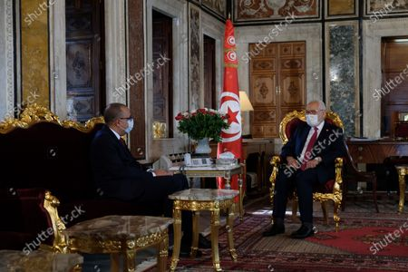 President of Tunisian parliament Rached Ghannouchi recieves Prime minister designate Hichem Mechichi in his office.