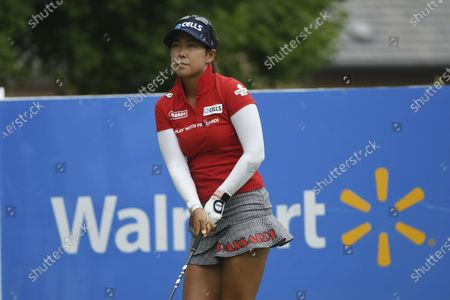 Jenny Shin of Korea watches her tee shot on the first hole during the final round of the LPGA Walmart NW Arkansas Championship golf tournament, in Rogers, Ark