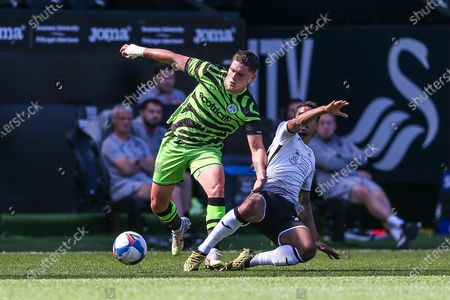 Forest Green Rovers Matt Stevens(9) rides a tackle by Swansea City's Kyle Naughton(26) during the Pre-Season Friendly match between Swansea City and Forest Green Rovers at the Liberty Stadium, Swansea