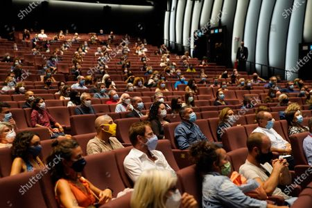 Stock Image of Spectators at the new film by director Andrea Segre screening, the docufilm 'Molecole', made in the Venice during lockdown  for the coronavirus presented in the Sala Darsena and at the PalaBiennale at the 77th annual Venice International Film Festival, in Venice, Italy, 01 September 2020.