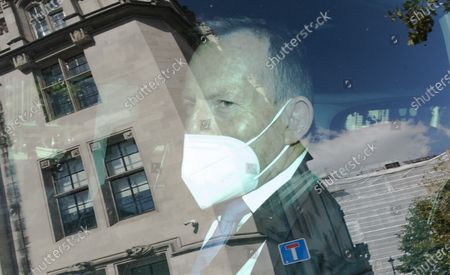 Former Australian Prime Minister Tony Abbott wearing a protective mask is driven away from 8 Great George Street after speaking at a Policy Exchange event in London, Britain on 01 September 2020.