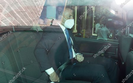 Former Australian Prime Minister Tony Abbott wearing a protective face mask is driven away from 8 Great George Street after speaking at a Policy Exchange event in London, Britain, 01 September 2020.