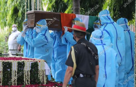 Indian people wearing Personal Protective Equipment (PPE) carry the mortal remains of former President of India, Pranab Mukherjee for his cremation at the Lodhi road crematorium, in New Delhi, India, 01 September 2020. Pranab Mukherjee died at the Army's Research and Referral Hospital in Delhi at the age of 84. The former president had undergone a brain surgery at the hospital and he was also detected positive for Covid19.