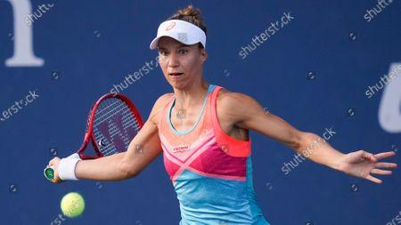 Stock Photo of Viktorija Golubic, of Switzerland, returns a shot to Vera Lapko, of Belarus, during the first round of the US Open tennis championships, in New York