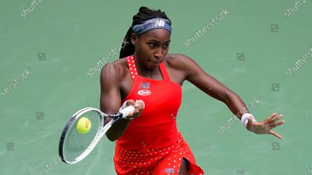 Coco Gauff, of the United States, returns a shot to Anastasija Sevastova, of Latvia, during the first round of the US Open tennis championships, in New York