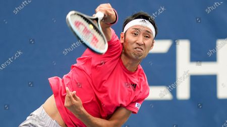 Yasutaka Uchiyama, of Japan, serves to Pablo Carreno Busta, of Spain, during the first round of the US Open tennis championships, in New York