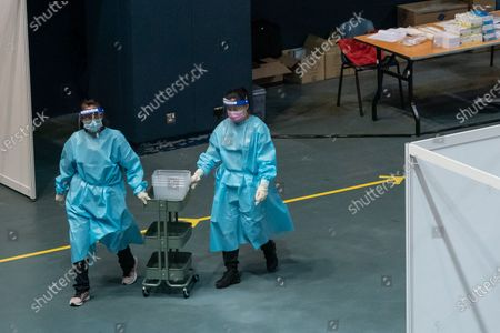 Medical professions push a collecting cart at a makeshift testing site in the Queen Elizabeth Stadium in Hong Kong, China, 01 September 2020. A Covid-19 testing programme begins at 141 sample collection centres across all 18 districts in city.