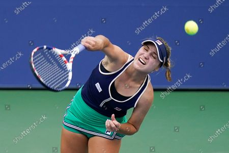 Sofia Kenin, of the United States, returns a shot to Yanina Wickmayer, of Belgium, during the first round of the US Open tennis championships, in New York