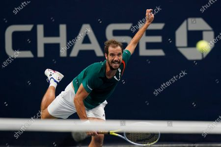 Richard Gasquet, of France, returns a shot to Ivo Karlovic, of Croatia, during the first round of the US Open tennis championships, in New York