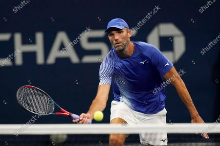 Ivo Karlovic, of Croatia, returns a shot to Richard Gasquet, of France, during the first round of the U.S. Open tennis championships, in New York