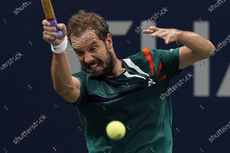 Richard Gasquet, of France, returns a shot to Ivo Karlovic, of Croatia, during the first round of the U.S. Open tennis championships, in New York