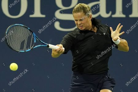 Kim Clijsters, of Belgium, returns a shot to Ekaterina Alexandrova, of Russia, during the first round of the U.S. Open tennis championships, in New York