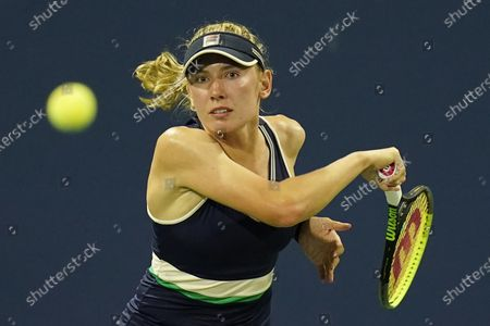 Ekaterina Alexandrova, of Russia, returns a shot to Kim Clijsters, of Belgium, during the first round of the U.S. Open tennis championships, in New York