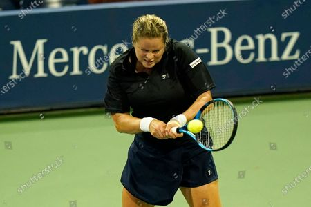 Stock Image of Kim Clijsters, of Belgium, returns a shot to Ekaterina Alexandrova, of Russia, during the first round of the U.S. Open tennis championships, in New York