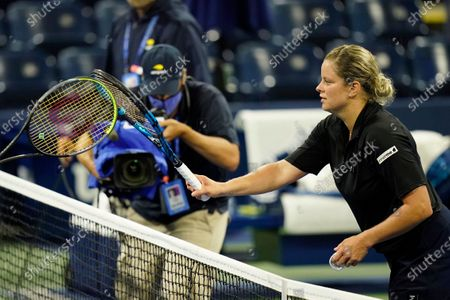Kim Clijsters, of Belgium, taps racquets with Ekaterina Alexandrova, of Russia, after loosing her match during the first round of the U.S. Open tennis championships, in New York