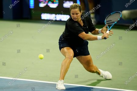Stock Picture of Kim Clijsters, of Belgium, returns a shot to Ekaterina Alexandrova, of Russia, during the first round of the U.S. Open tennis championships, in New York