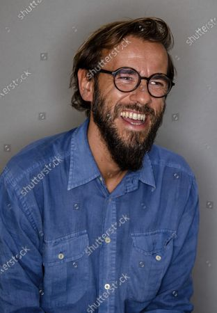 Director Andrea Segre poses for portraits, after an interview with The Associated Press where he talked about his documentary movie 'Molecole' (Molecules) that will premier today as the 77th edition of the Venice Film Festival pre-opening movie at the Venice Lido, Italy