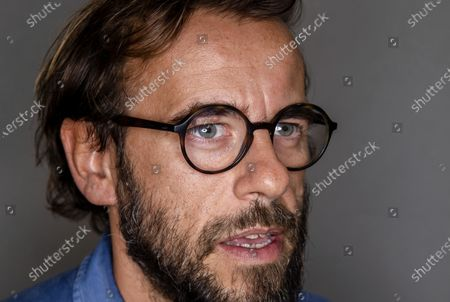 Stock Picture of Director Andrea Segre poses for portraits, after an interview with The Associated Press where he talked about his documentary movie 'Molecole' (Molecules) that will premier today as the 77th edition of the Venice Film Festival pre-opening movie at the Venice Lido, Italy