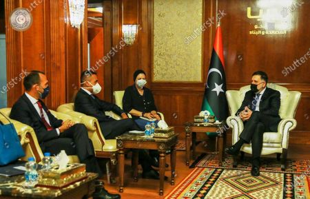 Libya's internationally recognized Prime Minister Fayez al-Sarraj, right, meets with Italian Foreign Minister Luigi Di Maio, second from the left, in Tripoli, Libya