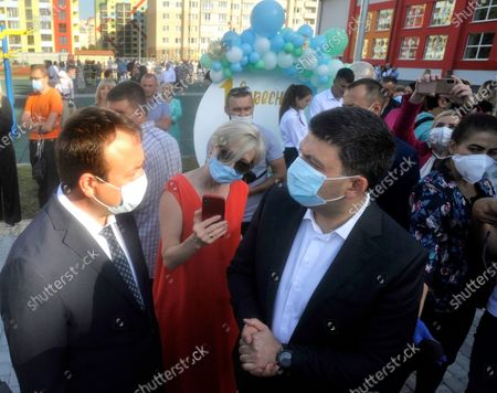 Head of the Vinnytsia Regional State Administration Serhii Borzov (L) and ex-premier Volodymyr Groysman attend the First Bell event at gymnasium N24 held in celebration of the new school year, Vinnytsia, central Ukraine. The academic institution built under the Great Construction National Programme is capable of admitting 1,200 students.