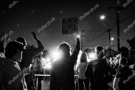 Protesters gather in solidarity where Dijon Kizzee was killed by the Los Angeles County Sheriff's Department