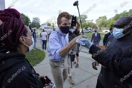 Rep. Joe Kennedy III, D-Mass., center, greets people during a campaign stop, in Boston. Kennedy, a candidate in the Sept. 1 primary election, is challenging incumbent U.S. Sen. Ed Markey, D-Mass., for a seat in the Senate