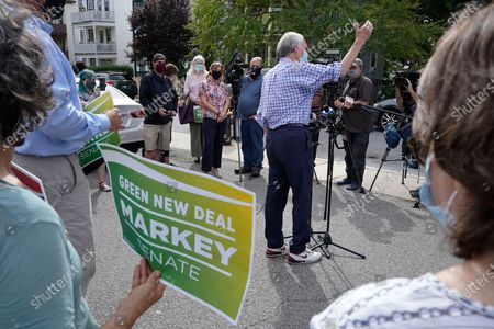 Sen. Ed Markey, D-Mass., center right, is flanked by supporters as he addresses members of the media, behind, during a campaign stop, in Boston. Markey, 73, is running in the Tuesday, Sept. 1 primary against U.S. Rep. Joe Kennedy, D-Mass., for a second full term in the Senate
